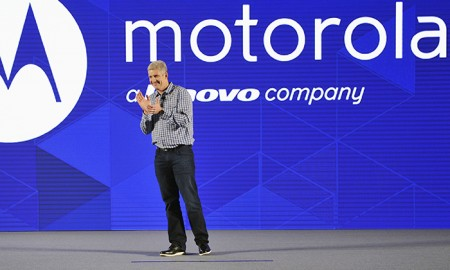 Rick Osterloh, President and Chief Operating Officer of Motorola Mobility, claps during a launch event of its new smartphone products in Beijing, January 26, 2015. Lenovo Group Ltd, the world's leading PC maker, said on Tuesday its third-quarter revenue rose 31 percent to $14.1 billion, beating investor expectations, as its mobile division sales more than doubled following its acquisition of Motorola. Picture taken January 26, 2015. REUTERS/Stringer (CHINA - Tags: BUSINESS SCIENCE TECHNOLOGY TELECOMS) CHINA OUT. NO COMMERCIAL OR EDITORIAL SALES IN CHINA - RTR4NZZP