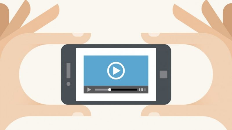 Mobile-phone-with-video-player-in-the-hands-iStock_000026535809_Illustration-940x529